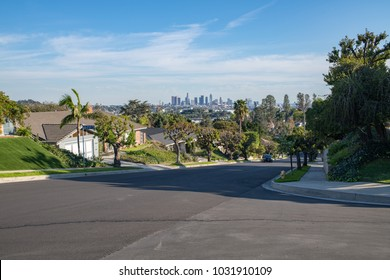 Los Angeles, CA: February 16, 2018:  A Los Angeles residential street with the Downtown Los Angeles skyline in the background.  Los Angeles is the second largest city in the United States.