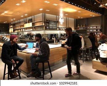 Los Angeles, CA: February 20, 2018: Starbucks Reserve customers inside a Los Angeles Starbucks Reserve store. Starbucks has plans to open several hundred Starbucks Reserve stores in the world.