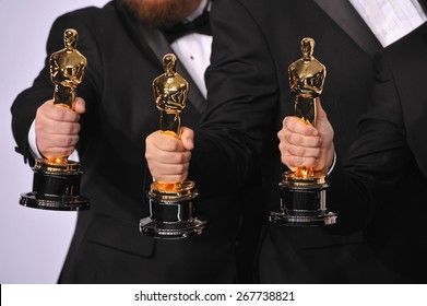 LOS ANGELES, CA - FEBRUARY 22, 2015: Trio of Oscar trophies at the 87th Annual Academy Awards at the Dolby Theatre, Hollywood.