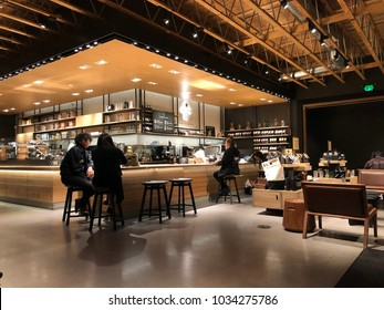 Los Angeles, CA: February 26, 2018: Starbucks Reserve customers inside a Los Angeles Starbucks Reserve store. Starbucks has plans to open several hundred Starbucks Reserve stores in the world.