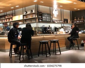 Los Angeles, CA: February 26, 2018: Starbucks Reserve customers inside a Los Angeles Starbucks Reserve store. Starbucks has plans to open several hundred Starbucks Reserve stores in the world.
