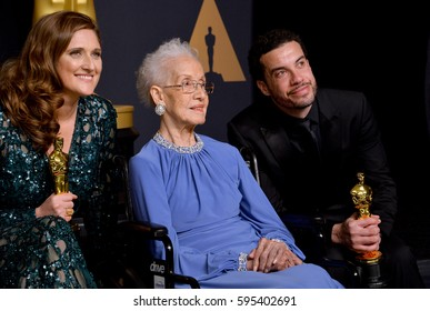 LOS ANGELES, CA. February 26, 2017: Ezra Edelman & Caroline Waterlow & NASA mathematician Katherine Johnson in the photo room at the 89th Annual Academy Awards at the Dolby Theatre, Los Angeles.