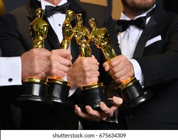 LOS ANGELES, CA - FEBRUARY 26, 2017. Oscar winners holding their awards in the photo room at the 89th Annual Academy Awards at Dolby Theatre, Los Angeles