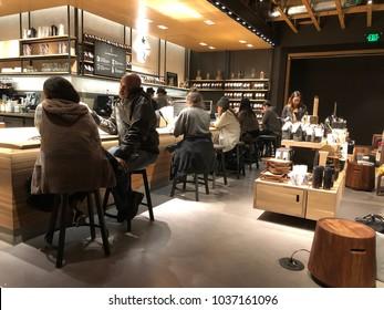 Los Angeles, CA: February 28, 2018: Starbucks Reserve customers inside a Los Angeles Starbucks Reserve store. Starbucks has plans to open several hundred Starbucks Reserve stores in the world.