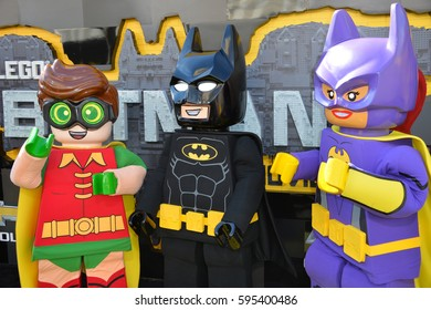 """LOS ANGELES, CA. February 4, 2017: Batman, Robin & Catwoman characters at the world premiere of """"The Lego Batman Movie"""" at the Regency Village Theatre, Westwood"""