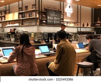 Los Angeles, CA: February 6, 2018:  Starbucks Reserve customers inside a Los Angeles Starbucks Reserve store.    Starbucks has plans to open several hundred Starbucks Reserve stores in the world.