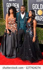 LOS ANGELES, CA. January 06, 2019: Idris Elba, Isan Elba & Sabrina Dhowre at the 2019 Golden Globe Awards at the Beverly Hilton Hotel.