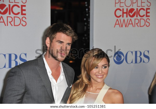 LOS ANGELES, CA - JANUARY 11, 2012: Miley Cyrus & Liam Hemsworth at the 2012 People's Choice Awards at the Nokia Theatre L.A. Live. January 11, 2012  Los Angeles, CA
