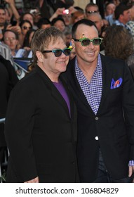 "LOS ANGELES, CA - JANUARY 23, 2011: Elton John & David Furnish (right) at the premiere of their animated movie ""Gnomeo & Juliet"" at the El Capitan Theatre, Hollywood January 23, 2011  Los Angeles, CA"