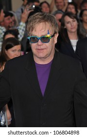 "LOS ANGELES, CA - JANUARY 23, 2011: Elton John at the world premiere of his new animated movie ""Gnomeo & Juliet"" at the El Capitan Theatre, Hollywood. January 23, 2011  Los Angeles, CA"
