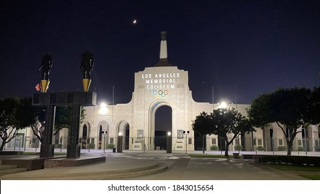 LOS ANGELES, CA, JUL 2020: entrance to Los Angeles Memorial Coliseum, home of the USC Trojans and the Los Angeles Rams, in Exposition Park at night