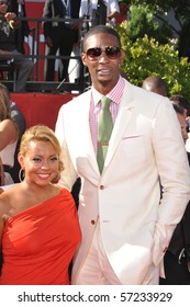 LOS ANGELES CA - JULY 15: An NBA Power Forward Chris Bosh and girlfriend, on the red carpet of the 2010 ESPY Awards at the Nokia Theater at LA Live, on July 15, 2010 in Los Angeles, CA