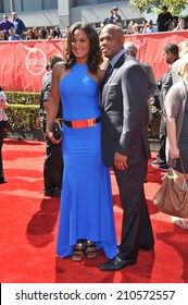 LOS ANGELES, CA - JULY 16, 2014: Boxer Laila Ali, daughter of Muhammed Ali, & husband Curtis Conway at the 2014 ESPY Awards at the Nokia Theatre LA Live.
