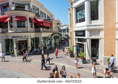 Los Angeles, CA: July 16, 2016: exterior of the Michael Kors and J.Crew stores at The Grove in Los Angeles.  The Grove is an upscale luxury retailer that opened in 2002.