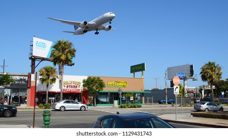 Los Angeles, CA - July 1st, 2018: A United Airlines Boeing 787 Flying over a Street while Landing at Los Angeles International Airport