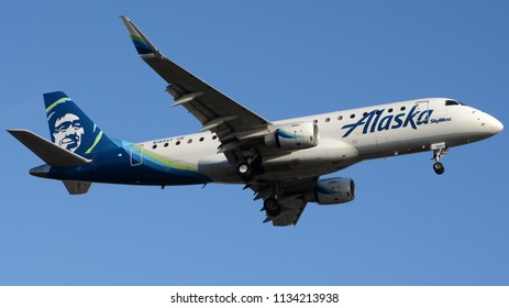 Los Angeles, CA - July 1st, 2018: An Alaska Airlines Embraer ERJ-175LR Landing at Los Angeles International Airport
