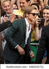 """Los Angeles, CA - July 22, 2019: Brad Pitt poses for fans before The Los Angeles Premiere Of  """"Once Upon a Time in Hollywood"""" held at TCL Chinese Theatre"""