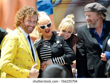 """LOS ANGELES, CA - July 23, 2017: TJ Miller, Christina Aguilera, Anna Faris, Steven Wright at the world premiere for """"The Emoji Movie"""" at the Regency Village Theatre, Westwood"""