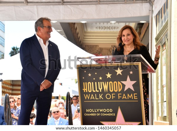 LOS ANGELES, CA. July 24, 2019: Kenny Ortega & Kathy Najimy at the Hollywood Walk of Fame Star Ceremony honoring Kenny Ortega.Pictures: Paul Smith/Featureflash