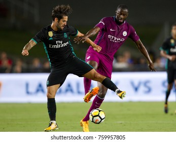 LOS ANGELES, CA - JULY 26: Isco & Yaya Toure during the 2017 International Champions Cup game between Manchester City and Real Madrid on July 26th 2017 at the Los Angeles Memorial Coliseum.