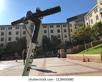 Los Angeles, CA: July 3, 2018: A Bird electric scooter on the University of California, Los Angeles, campus.  Bird produces electric scooters that can be rented by the public.