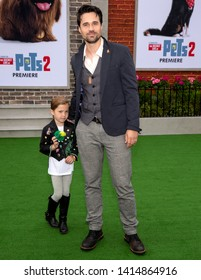 "Los Angeles, CA - June 02, 2019: Brett Dalton (R) and daughter Sylvia  attend the Premiere Of Universal Pictures' ""The Secret Life Of Pets 2"" held at Regency Village Theatre"