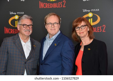 "LOS ANGELES, CA - June 05, 2018: John Walker, Brad Bird & Nicole Paradis Grindle at the premiere for ""Incredibles 2"" at the El Capitan Theatre"