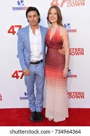 "LOS ANGELES, CA - June 12, 2017: Yani Gellman & Guest at the Los Angeles premiere for ""47 Meters Down"" at the Regency Village Theatre, Westwood."