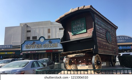 LOS ANGELES, CA, JUNE 2018: stagecoach on display with retro signage at Gower's Gulch, strip mall, formerly a location for casting westerns at the intersection of Sunset and Gower in Hollywood