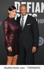 """LOS ANGELES, CA - June 22, 2017: Dr. Dre & Nicole Young at the premiere for the HBO documentary series """"The Defiant Ones"""" at the Paramount Theatre. Los Angeles,"""