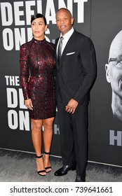 """LOS ANGELES, CA - JUNE 22, 2017: Dr. Dre & Nicole Young at the premiere for the HBO documentary series """"The Defiant Ones"""" at the Paramount Theatre. Los Angeles, USA"""