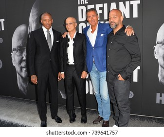 """LOS ANGELES, CA - JUNE 22, 2017: Dr. Dre, Jimmy Iovine, Richard Plepler & Allen Hughes at the premiere for the HBO documentary series """"The Defiant Ones"""" at the Paramount Theatre. Los Angeles, USA"""
