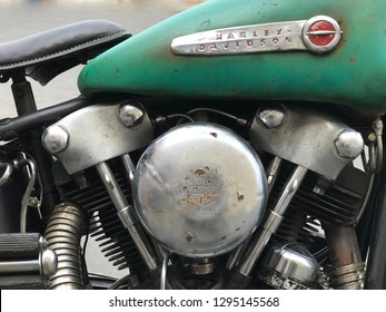 Los Angeles, CA - June 25, 2018: A vintage 1940s Harley Davidson motorcycle with a Knucklehead engine is shown parked outside in a closeup view.
