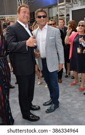 """LOS ANGELES, CA - JUNE 28, 2015: Arnold Schwarzenegger & Sylvester Stallone at the Los Angeles premiere of Schwarzenegger's movie """"Terminator Genisys"""" at the Dolby Theatre, Hollywood."""