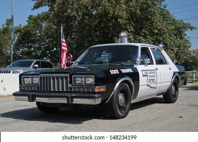 LOS ANGELES, CA. -  JUNE 29 : American Heroes Air Show - Old Vehicle Oklahoma Highway Patrol  on June 29, 2013 in Los Angeles, CA.