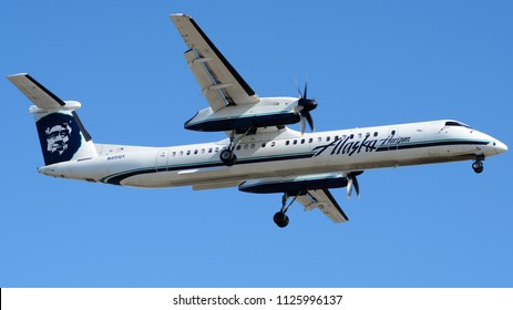 Los Angeles, CA - June 31st, 2018: An Alaska Airlines Dash-8 Q400 Landing at Los Angeles International Airport