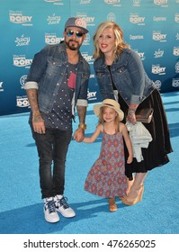 """LOS ANGELES, CA. June 8, 2016: Actor/musician A.J. McLean, of The backstreet Boys, & wife Rochelle Karidis & daughter at the world premiere for """"Finding Dory"""" at the El Capitan Theatre, Hollywood."""