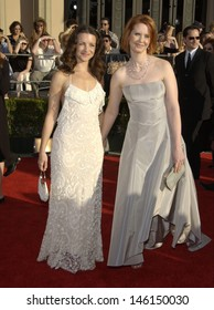 LOS ANGELES, CA - MARCH 10, 2002: Sex and the City stars KRISTEN DAVIS (left) & CYNTHIA NIXON at the 8th Annual Screen Actors Guild Awards in Los Angeles.