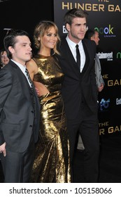 """LOS ANGELES, CA - MARCH 12, 2012: Jennifer Lawrence, Josh Hutcherson (left) & Liam Hemsworth at the world premiere of """"The Hunger Games"""" at the Nokia Theatre L.A. Live March 12, 2012  Los Angeles, CA"""