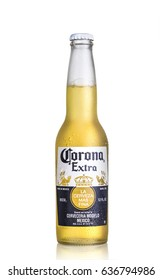 Los Angeles CA - March 15: Photo of a 12 ounce bottle of Corona Extra Beer isolated on white. Corona is produced by Grupo Modelo with Anheuser Busch InBev.