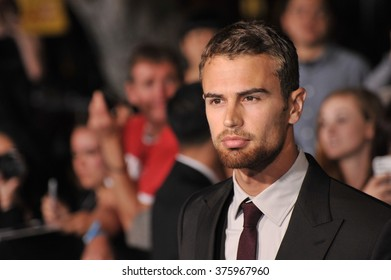 """LOS ANGELES, CA - MARCH 18, 2014: Theo James at the Los Angeles premiere of his movie """"Divergent"""" at the Regency Bruin Theatre, Westwood."""