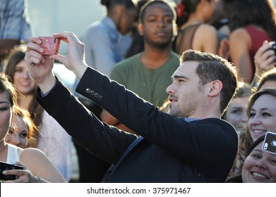 "LOS ANGELES, CA - MARCH 18, 2014: Grey Damon at the Los Angeles premiere of ""Divergent"" at the Regency Bruin Theatre, Westwood."