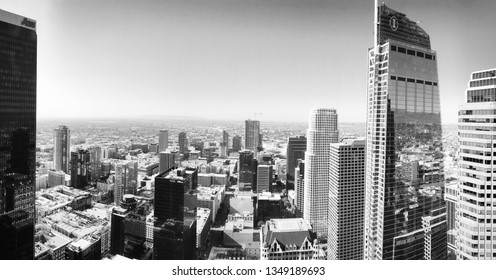 LOS ANGELES, CA, MARCH 2019: view looking south west across LA county from tall building in Downtown. AON Tower and Wilshire Grand skyscrapers on each side. Black and white
