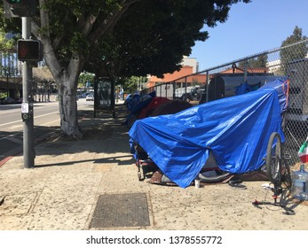 LOS ANGELES, CA, MARCH 2019: homeless encampment with tents and tarpaulins set up on street outside Grand Park, next to LA Police Dept headquarters and City Hall