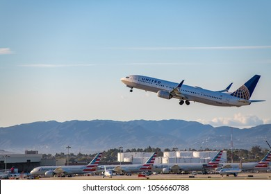 Los Angeles, CA: March 23, 2018: A United Airlines aircraft taking off at Los Angeles International Airport (LAX).  LAX is one of the  busiest airport in the world.