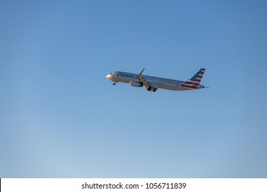 Los Angeles, CA: March 23, 2018: An American Airlines jet takes off at Los Angeles International Airport (LAX).   American Airlines began operations in 1936.
