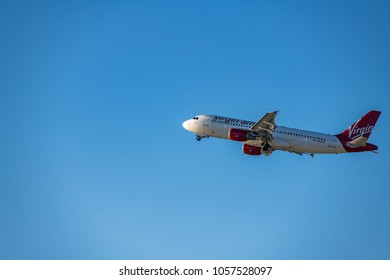 Los Angeles, CA: March 23, 2018: An A Virgin America jet takes off at Los Angeles International Airport (LAX). Virgin America will have a final flight on April 24, 2018.