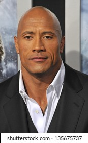 "LOS ANGELES, CA - MARCH 28, 2013: Dwayne Johnson, aka ""The Rock"" at the Los Angeles premiere of his movie ""G.I. Joe: Retaliation"" at the Chinese Theatre, Hollywood."