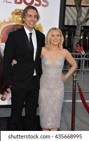 """LOS ANGELES, CA - MARCH 28, 2016: Kristen Bell & husband Dax Shepard at the premiere for her movie """"The Boss"""" at the Regency Village Theatre, Westwood."""