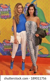 LOS ANGELES, CA - MARCH 29, 2014: Model Gigi Hadid (left) & sister Bella at Nickelodeon's 27th Annual Kids' Choice Awards at the Galen Centre, Los Angeles.